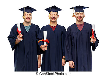 male graduates in mortar boards with diplomas