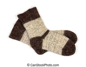 male grey knitted socks of dog fur on white background close-up, top view