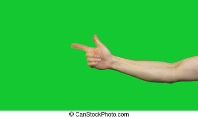 Male gun gesture on green background - Footage of male hands...