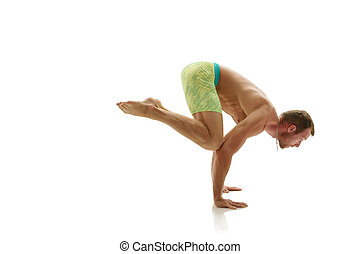 Male gymnast doing handstand. Isolated on white