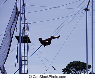Male gymnast on trapeze