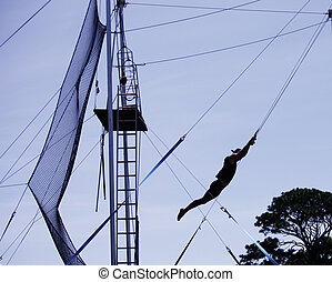 Male gymnast on trapeze silhouette
