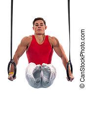 Male Gymnast - Young adult male gymnast. Studio shot over...
