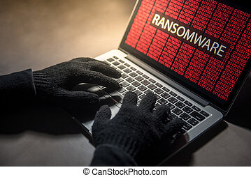 Male hacker hand hacking into computer operating system. ...