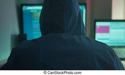 Male hacker internet working on a computer. man hacker...