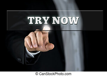 Try now button - Male hand activating a Try now button on ...