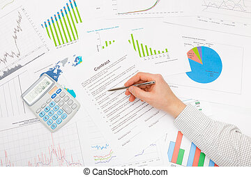 Male hand and financial charts and graphs