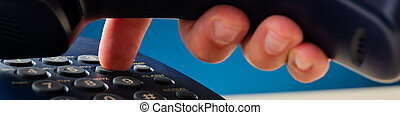 Male hand dialing telephone number - Closeup view of male...