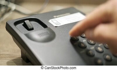 Male hand dials emergency number on the phone - Male hand...