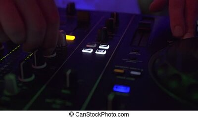Male hand disk jockey on mixing console for mixing techo...