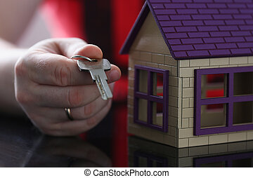 Male hand hold silver key giving