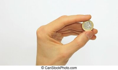 Male Hand Holding 1 Euro Coin