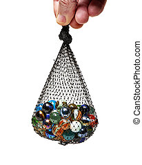 Male hand holding a Bag of Multicolored marbles isolated on...