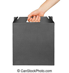 Male hand holding black cardboard box with handle