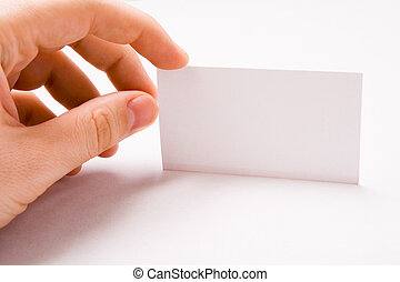 Male hand holding blank business card over white