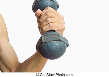 Male hand holding dumbbell isolated on white background