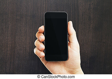 Male hand holding empty phone