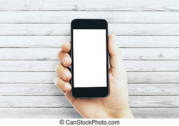 Male hand holding empty white smartphone