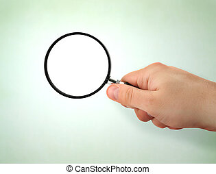 male hand holding magnifying glass