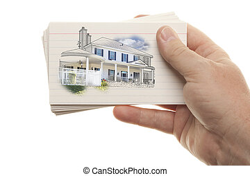 Male Hand Holding Stack of Flash Cards with House Drawing