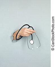 male hand holding stethoscope