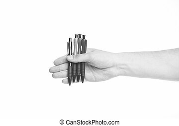 Male hand holds four pens isolated white background. Office ...