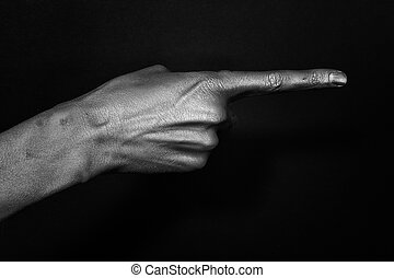 Male hand indicate in the silver make-up