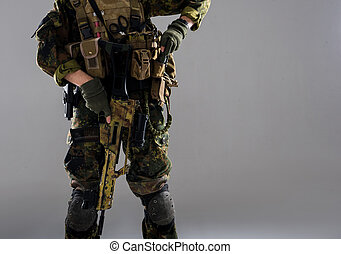 Male hand keeping assault rifle - Close up man arm in...