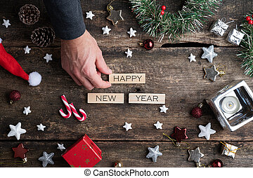 Male hand making a Happy new year sign