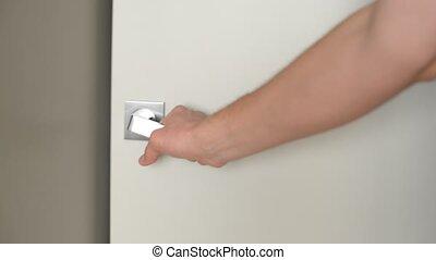 Male Hand Opening Door in Living Room.