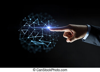 business, people, network and technology concept - close up of businessman hand pointing finger to polygonal virtual projection over black background