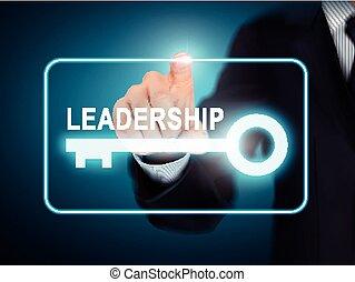 male hand pressing leadership key button