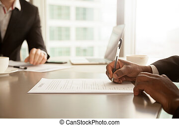 Male hand putting signature, signing partnership contract...