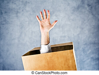 Male hand reaching out from the box