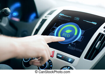 male hand setting car eco system mode on screen