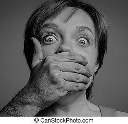 male hand shutting up woman
