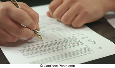 """Male hand signing pages of contract, work with official document"""