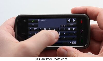Male hand typing texting with the i