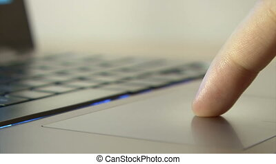 Male hand using laptop touch pad