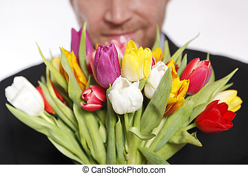 Male hand with bouquet of tulips, isolated