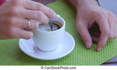 Male hand with cup of coffee