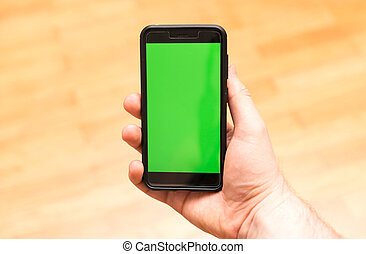 Male hand with Smartphone. Chroma key. Place for your advertisement.