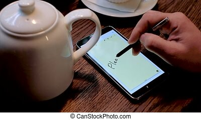 Male hand writes text Please forgive me on the screen of smart phone