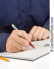 hand writing by pen on checked notebook