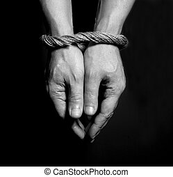 Male hands bound with rope. Addiction concept.