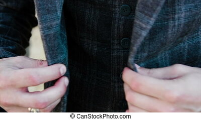 male hands buttoned jacket