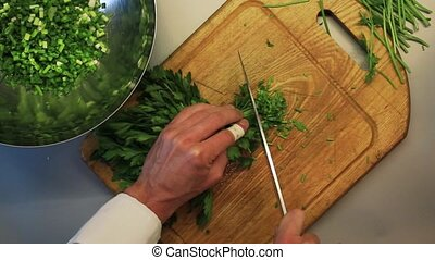 Male hands chopping green
