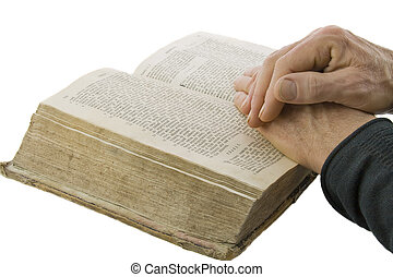 Male hands closed in prayer on an open bible isolated over white