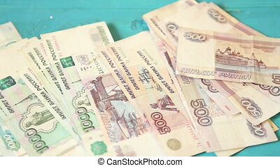 male hands collect the scattered paper notes, Russian Ruble