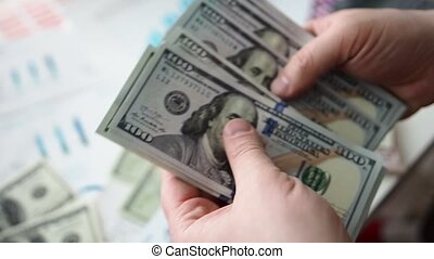Male hands counting huge pack of US dollars closeup